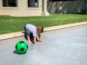 Child on pool cover